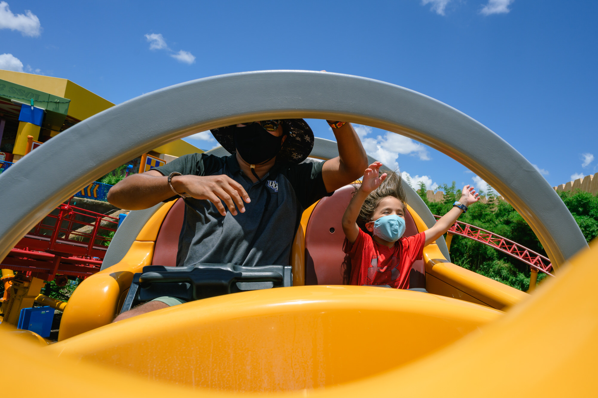 boy and dad ride Slinky Dog with mask on