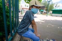 boy taking a break while in line