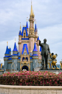 Walt and Mickey statue in front of the freshly painted castle