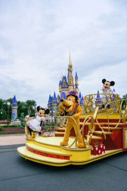 Mickey Parade float with Minnie and Pluto in front of the castle