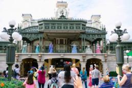 Disney Princesses greet the crowd below