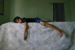floppy kid on bed