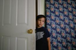 boy looking sad in doorway
