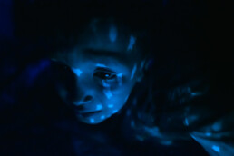 boy crying under blue star light