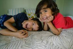 boys posing on bed