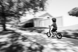 boy riding bike for first time without training wheels