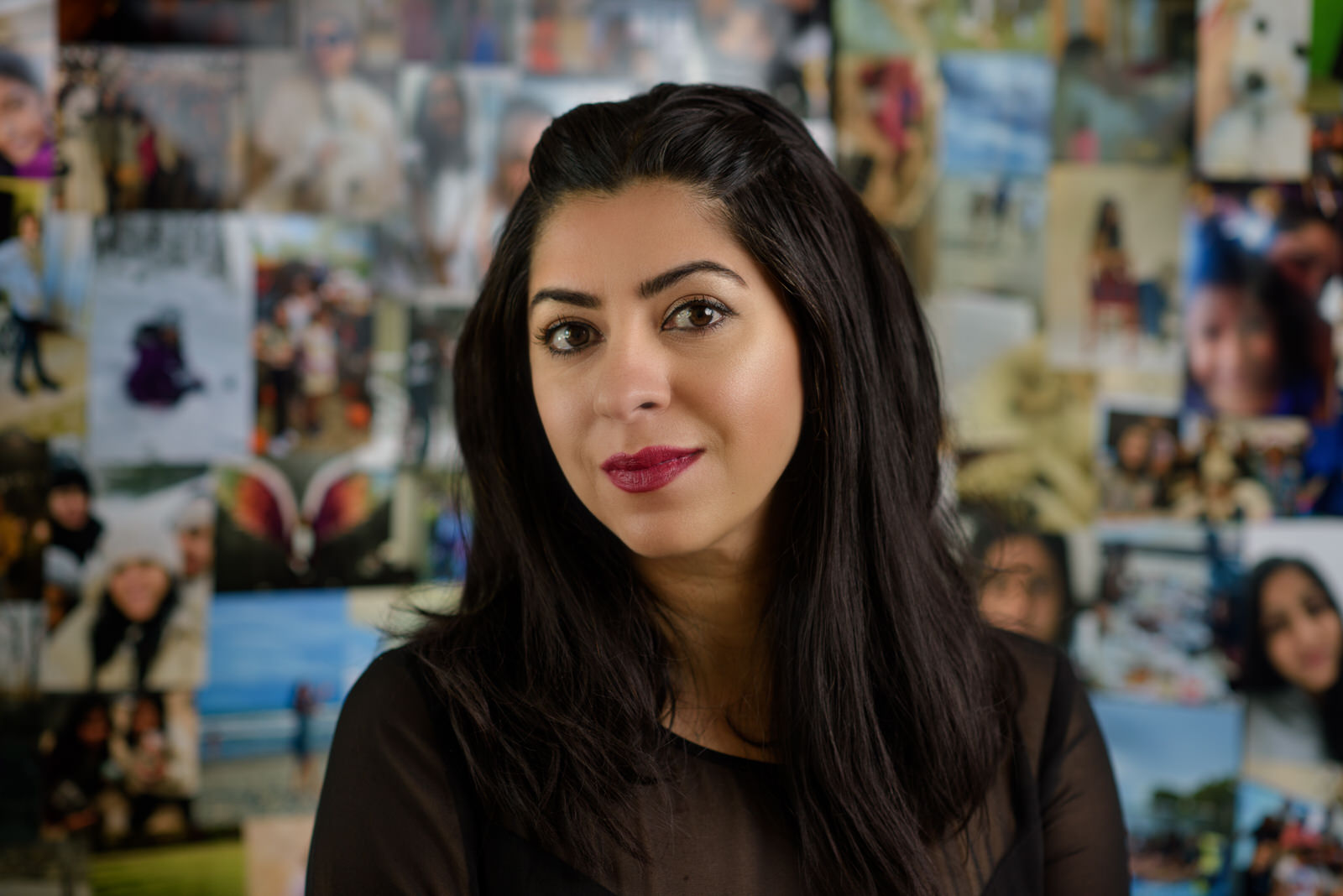 portrait of Mona Chaudhry in front of family images