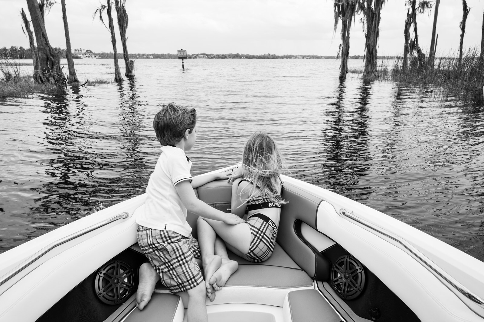 brother and sister enjoying a boat ride on the Butler chain of lakes