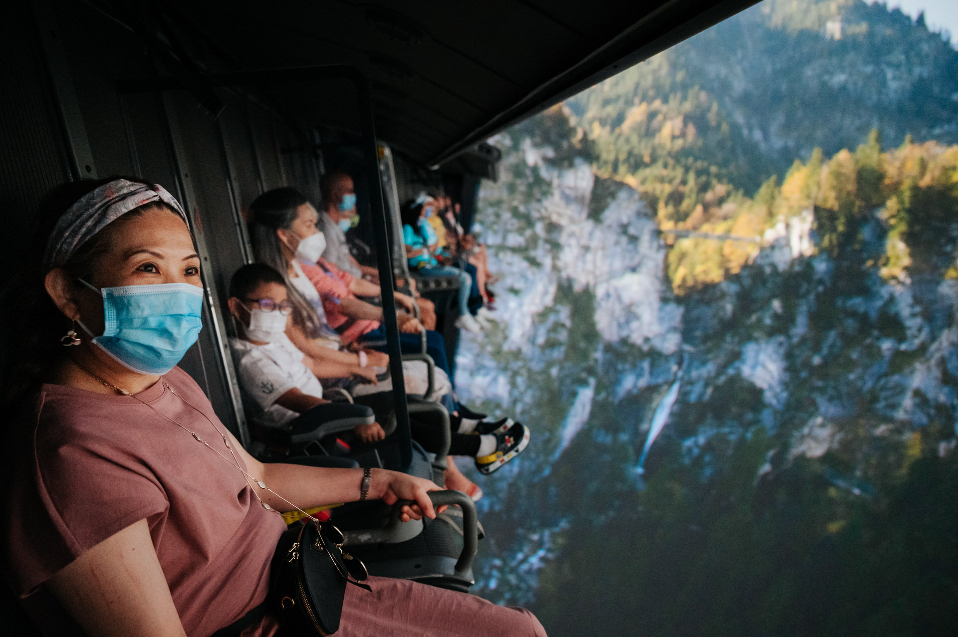 family enjoys soarin ride while mask mandate is in place