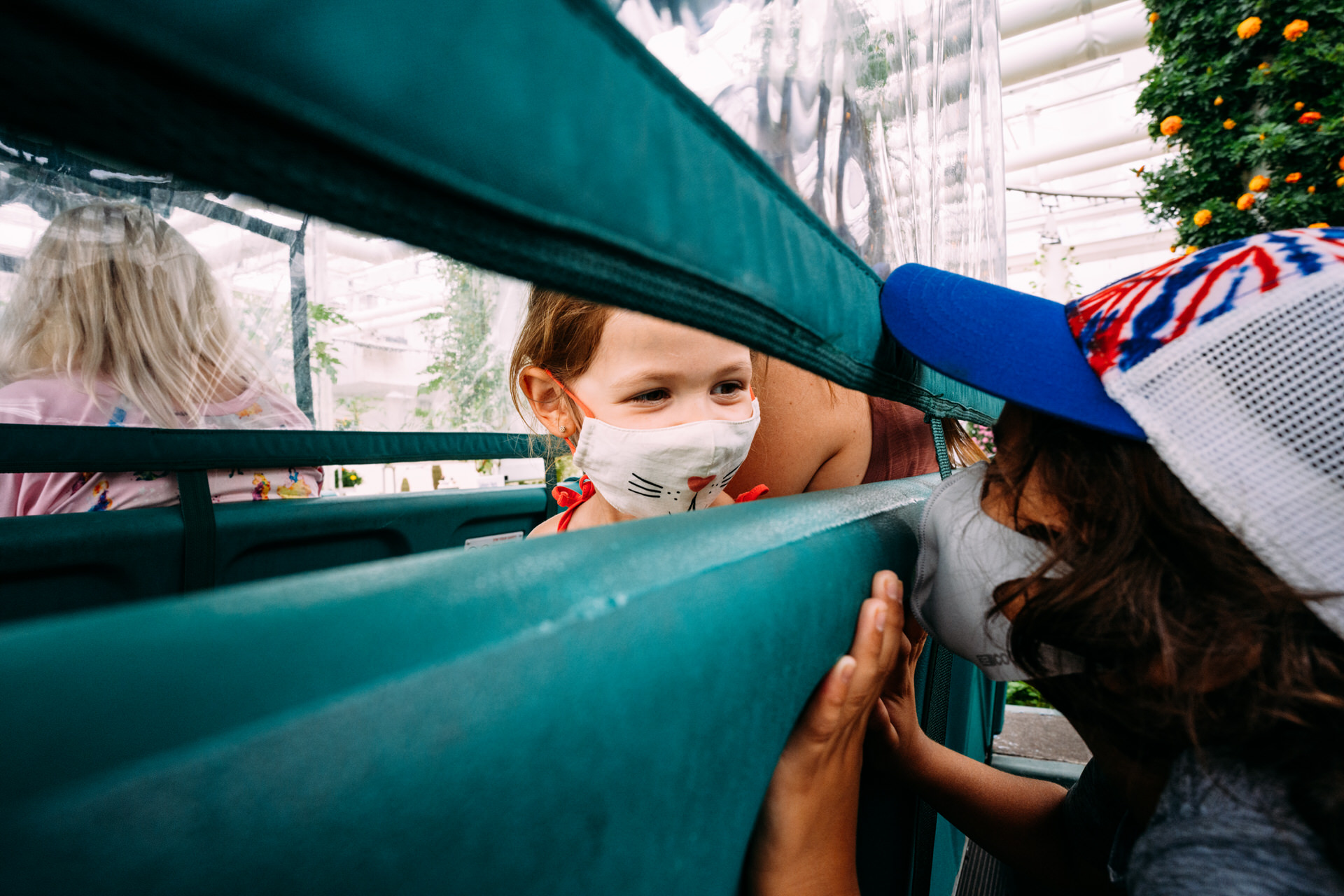 kids play through the protective dividers on Living with the Land