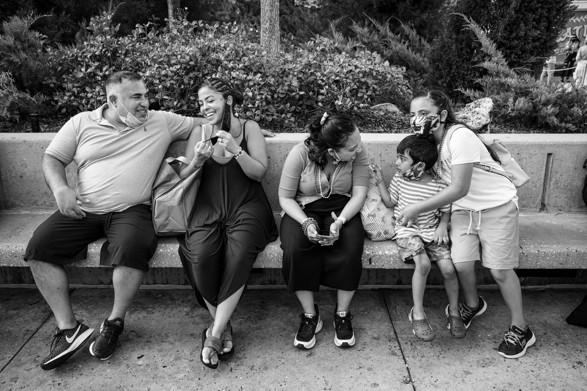family takes a break at Universal during covid mask wearing procedures in place